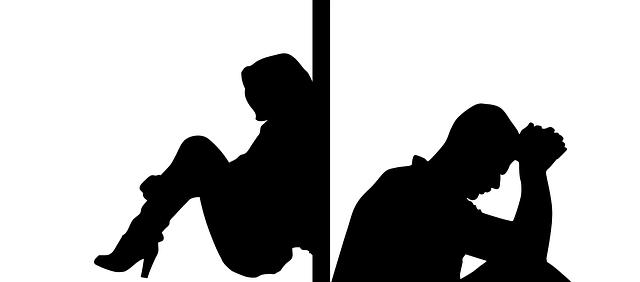 Oddělené siluety muž a žena.